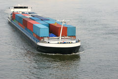 Cargo Ship. A large container cargo ship in a river Royalty Free Stock Photo
