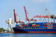 The cargo ship. With containers unloads in port Stock Images