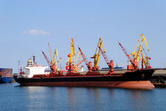 The cargo ship. With containers unloads in port Stock Photos