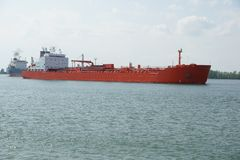 Cargo Ship. Bulk carrier cargo ship sailing on calm waters stock images