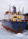 Cargo ship. A rusty cargo ship prisoner of ice Stock Photography