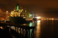 The Cargo Ship. Cargo ship docked at a warf at night Stock Image