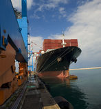 Cargo ship. At dock in port Royalty Free Stock Photography