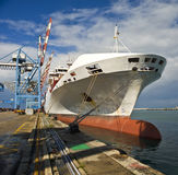 Cargo ship. At dock in port Royalty Free Stock Image