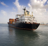 Cargo ship. Leaving the harbor Royalty Free Stock Images