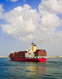 Cargo ship. Fully loaded cargo ship leaving the port Royalty Free Stock Photography