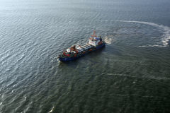 Cargo ship aerial view. Atlantic ocean Stock Photos