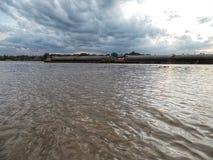 Cargo ship along over Chao praya river,bangkok Thailand. stock images