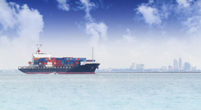 Cargo ship anchored in a harbor. Royalty Free Stock Image