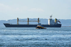 Free Cargo Ship And Tug Boat Royalty Free Stock Photography - 20572517