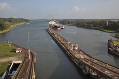 Cargo Ship approaching Panama Canal Locks. A freighter approaching first lock of Panama Canals Atlantic Entrance at Port of Colon Stock Photo