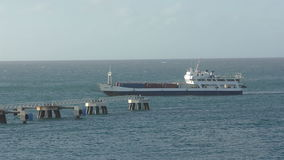 Cargo ship approaching St Maarten stock footage