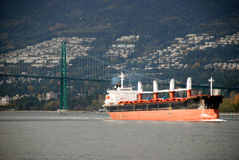 Cargo ship arrives in city Royalty Free Stock Photos