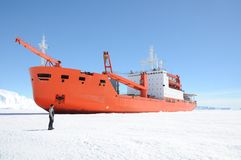 Cargo ship arrives in port for unloading on an ice floe. stock photo