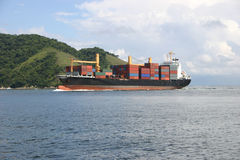 Cargo ship arriving Stock Image