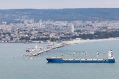 Cargo ship arriving in port. Tilt-shift effect Stock Images