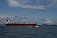 Cargo Ship in ballast. Large cargo ship traveling in ballast in Boundary Pass, Salish Sea, on its way to Vancouver, B.C Stock Photo