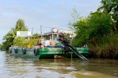 Cargo ship, barge loading. Goods. Mekong river delta Stock Photography