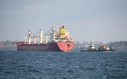 Cargo ship, Barge and Tugboat Stock Photos
