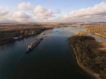 Cargo ship in beautiful river. Stock Image