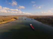 Cargo ship in beautiful river. Royalty Free Stock Photos