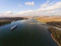 Cargo ship in beautiful river. Stock Photos