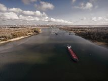 Cargo ship in beautiful river. Stock Photo