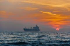 Cargo Ship At Beautiful sunset royalty free stock photos