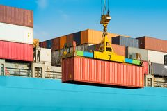 Cargo ship being loaded with containers. At port in Chile stock photos