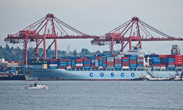 Cargo ship being loaded with containers, Port of Seattle Stock Photos