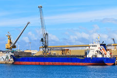 Cargo ship is being unloaded Royalty Free Stock Image