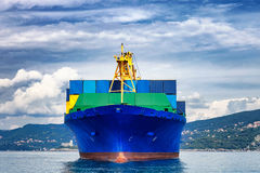 Cargo ship. Blue containers cargo ship on the sea Royalty Free Stock Image