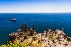 Cargo ship in the blue sea Royalty Free Stock Photo