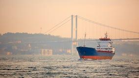 A cargo ship in the Bosphorus, Istanbul, Turkey. Stock Photos