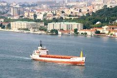 Cargo ship on Bosporus. Bulk carrier moves on Bosporus in Istanbul Stock Photos