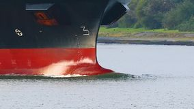 Ship bow splitting the water. Cargo ship bow front closeup stock footage