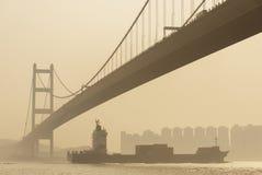 Cargo ship and Bridge Stock Photo