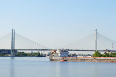 Cargo ship and cable-braced bridge Royalty Free Stock Images