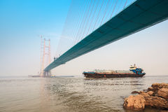 Cargo ship with cable stayed bridge Stock Photos