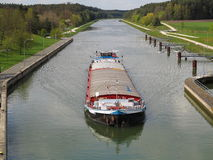 Cargo ship in canal Stock Photo