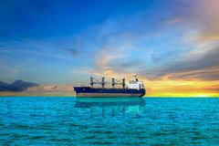 Cargo ship. Car ship in the sea on blue sky background Royalty Free Stock Image