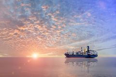 Cargo ship. Cargo containers ship at the port trad on sea and sunset background Stock Photography
