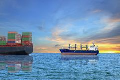 Cargo ship. And container ship in the sea on blue sky with sunset background soft light Stock Image