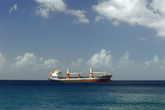 Cargo ship on Caribbean Sea Royalty Free Stock Photo