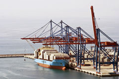 Cargo Ship in a port with cranes loading  Stock Photos