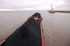 Cargo ship with coal at Kolyma river Russia outback Royalty Free Stock Images