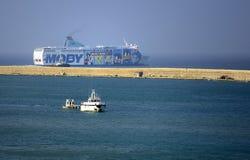 Cargo ship coming into port Stock Photo