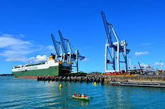 Cargo ship and container cranes on Fergusson Wharf Royalty Free Stock Photos