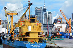 Cargo ship and container cranes on Fergusson Wharf at Ports of A Stock Photography