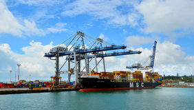 Cargo ship and container cranes on Fergusson Wharf at Ports of A Stock Photos